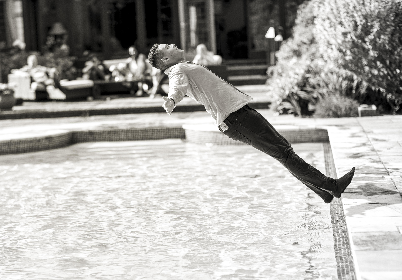 Man Falling in Pool